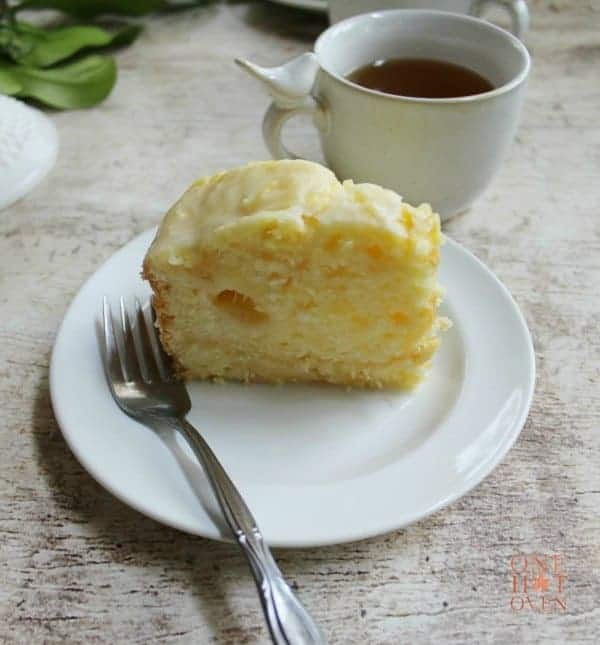 Slice of lemon cake with a cup of tea
