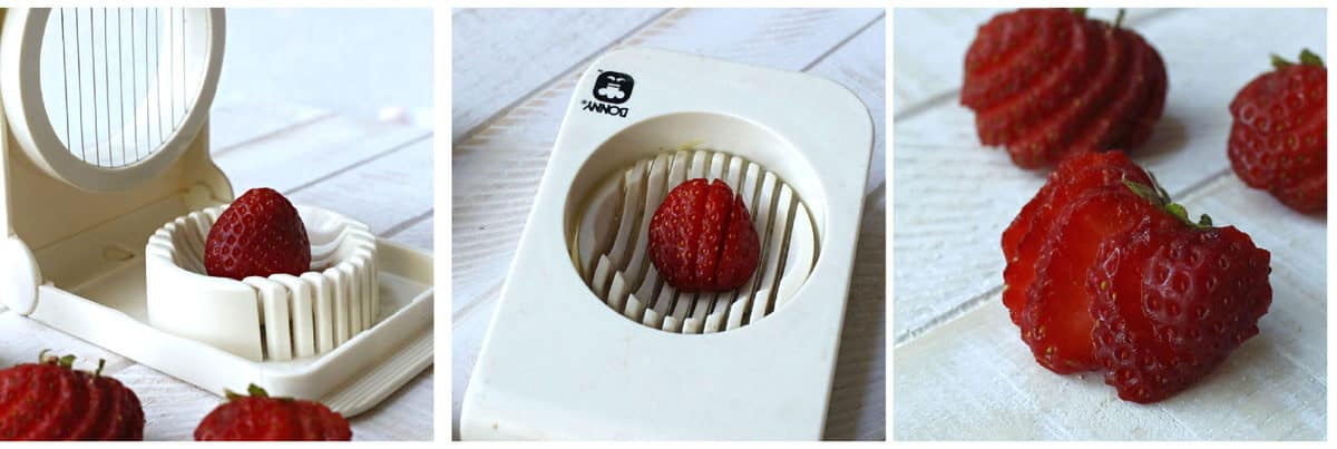 Slicing strawberries with a white strawberry slicer.
