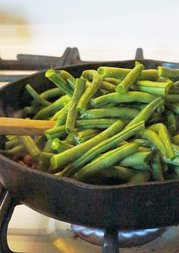 Fresh green beans in an iron skillet