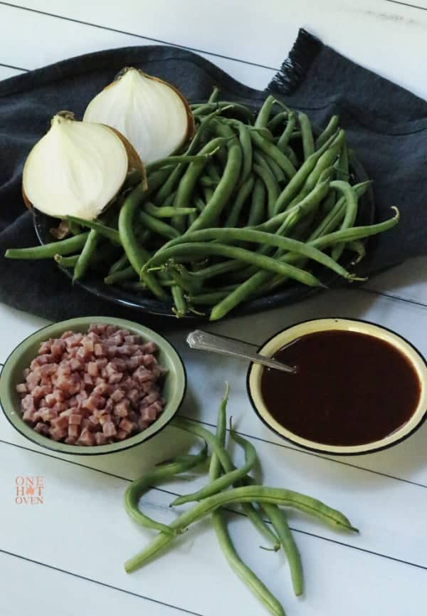 Ingredients to make BBQ'ed Green Beans. Green Beans, hame, onions and bbq sauce