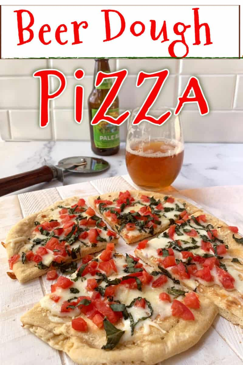 A slice margherita pizza and a beer.