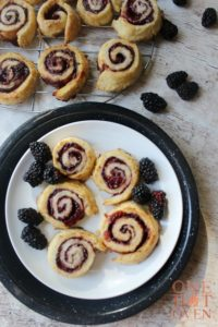 Baked jelly roll pie tarts on a plate