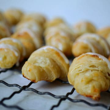 Baked Cottage Cheese Crescent Rolls with a sweet almond icing