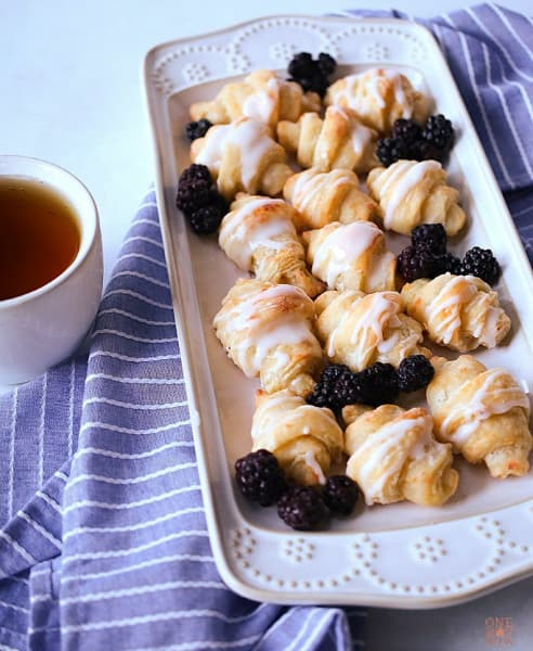 Glazed Cottage Cheese Crescent Rolls with blackerries and a cup of tea