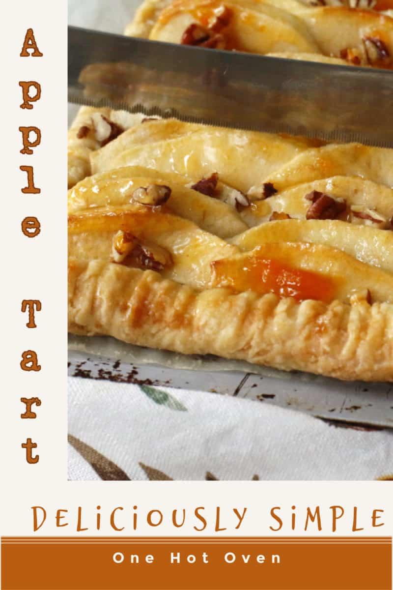 Cutting an apple pecan tart slice.