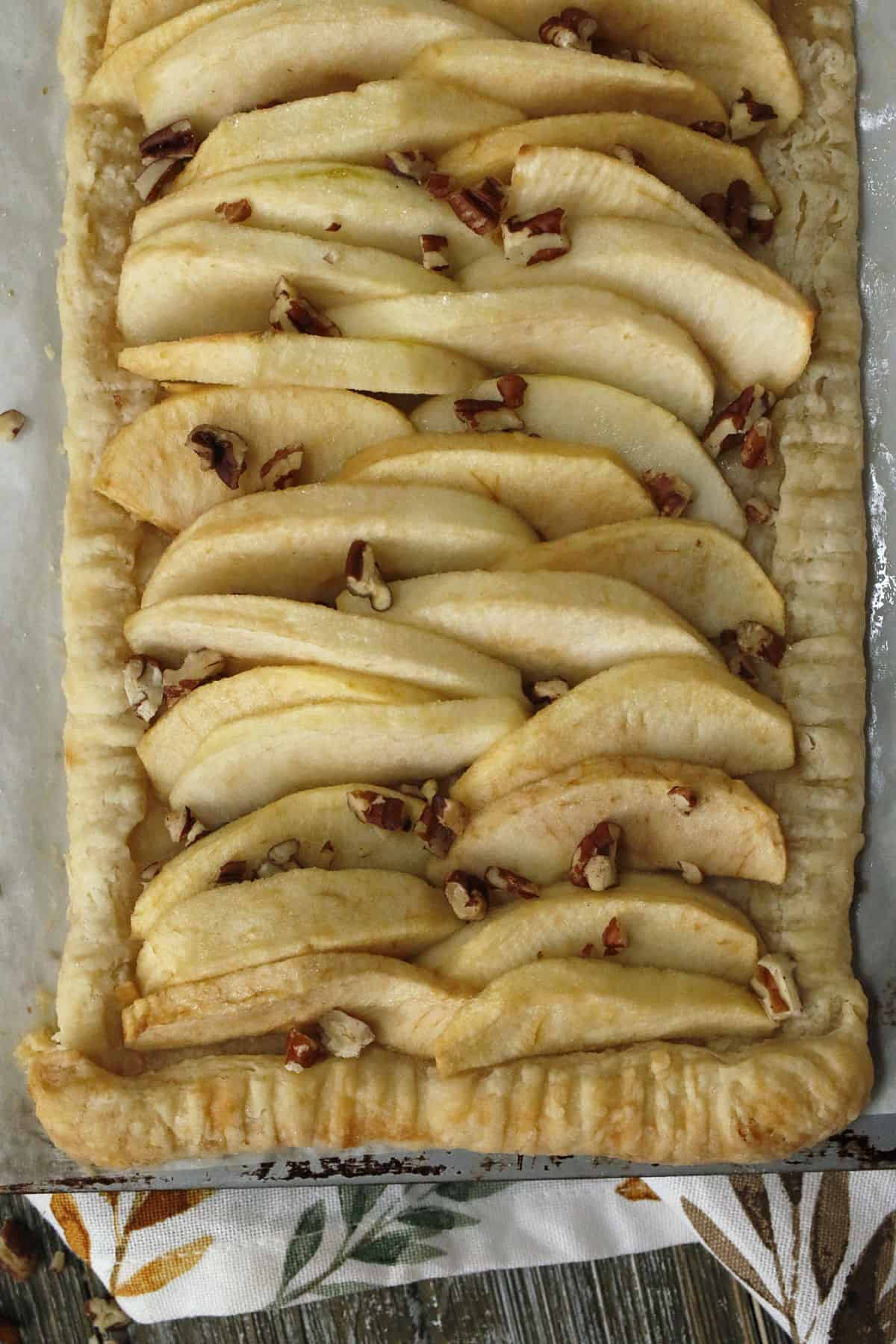 An apple tart with pecans.
