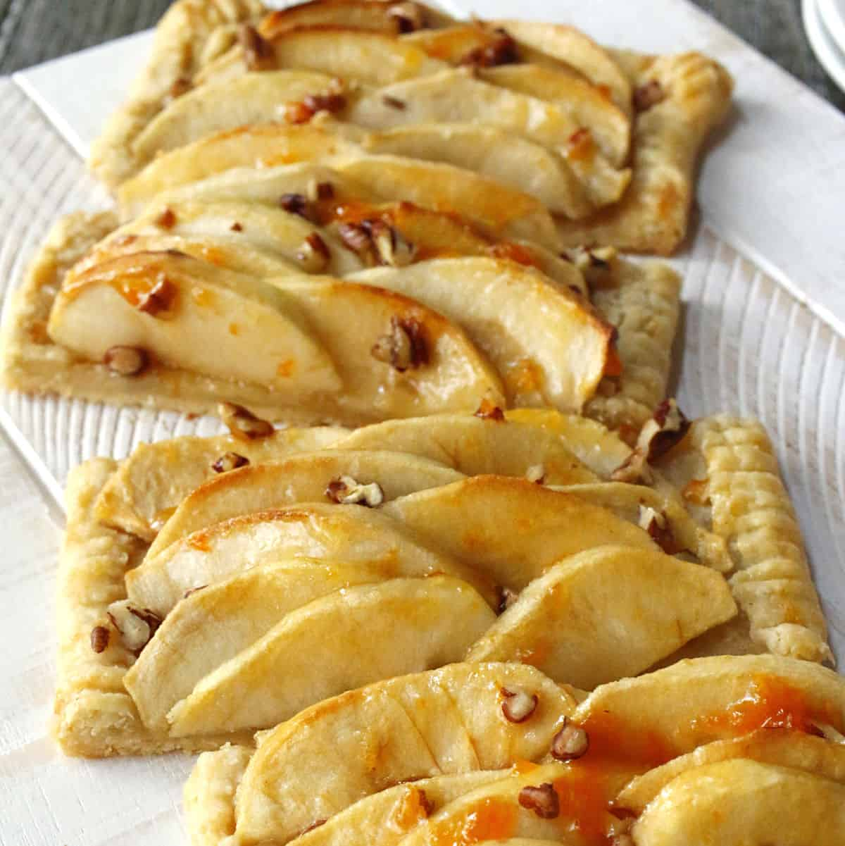 Slices of an apple tart with pecans.