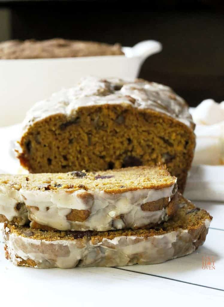 Slices of pumpkin cranberry bread with orange icing