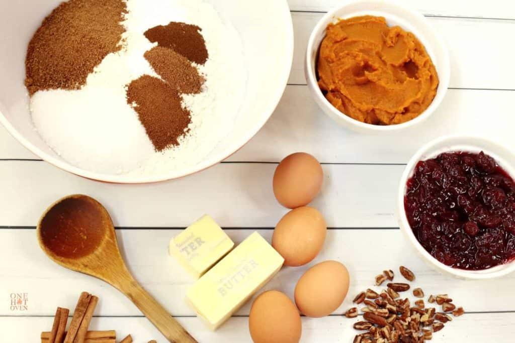 Pumpkin, butter, cranberry sauces, eggs, flour and spices for pumpkin cranberry bread.