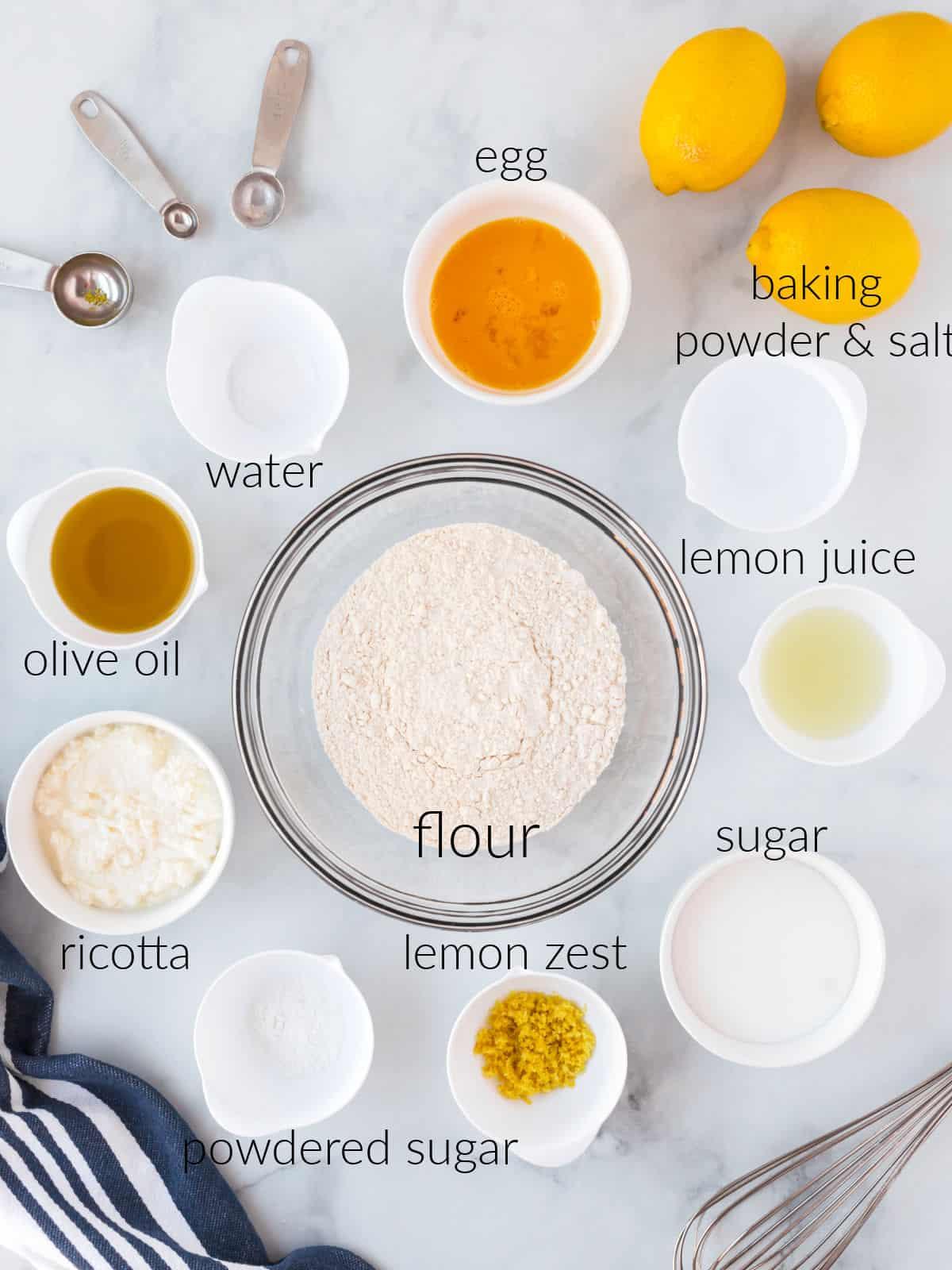 Ingredients to make lemon ricotta muffins.