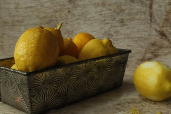 A bread pan filled with fresh picked lemons