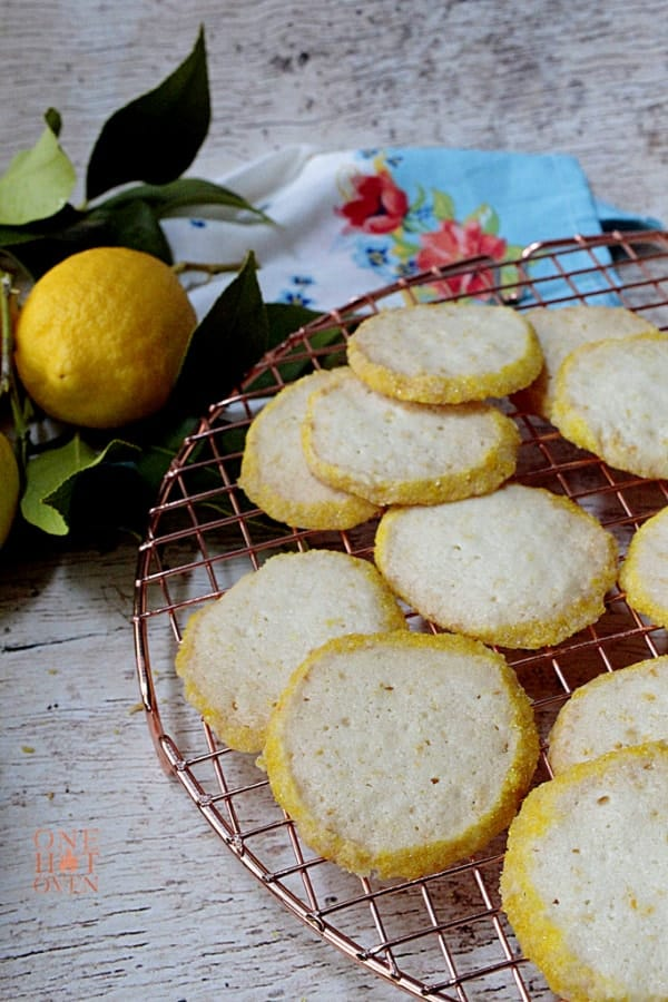 Crispy lemon shortbread cookies on a cooling rack