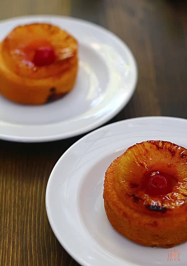 Grilled pineapple upside down cakes on plates