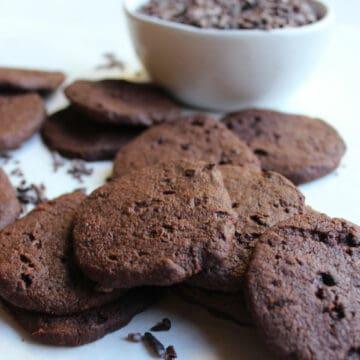Chocolate cacao nib cookies with cacao nibs.