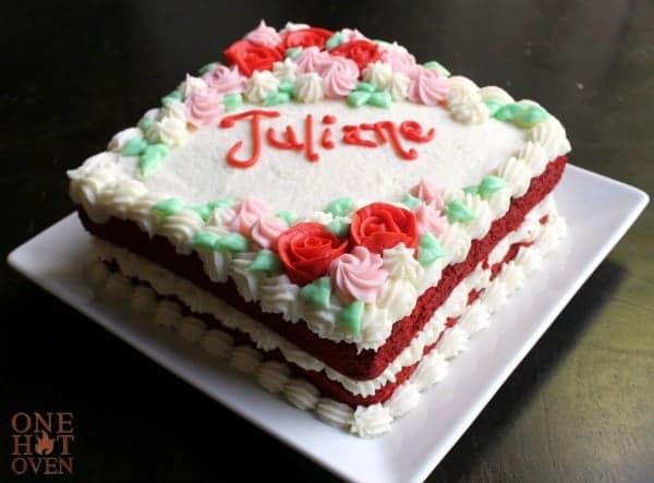 Red velvet cake on a white plate.