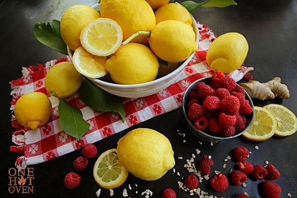 Fresh lemons, red raspberries and fresh ginger