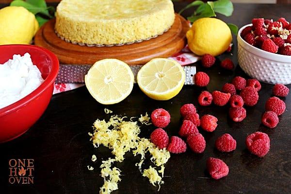 lemons, raspberries and a sponge cake
