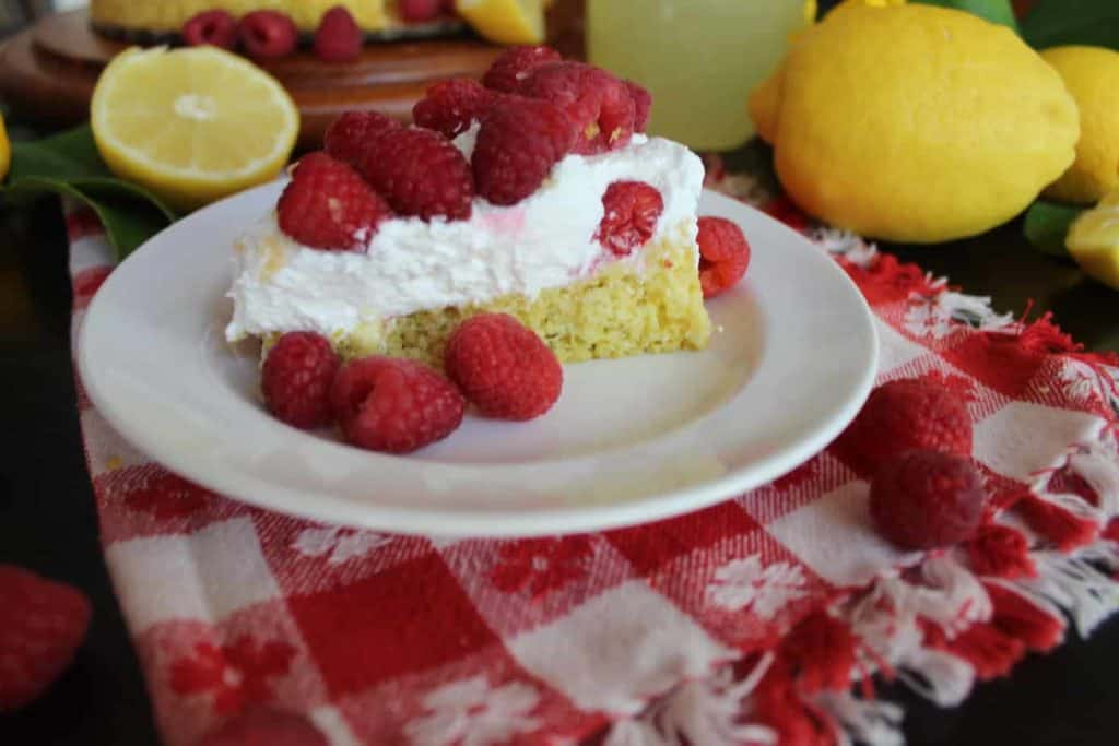 Lemon Ginger Sponge Cake with Raspberries and Whipped Cream