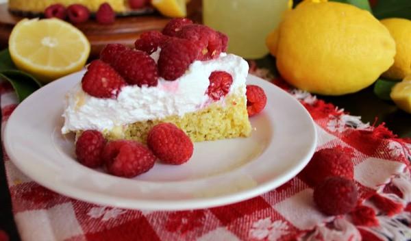 A slice of lemon and ginger sponge cake with raspberries