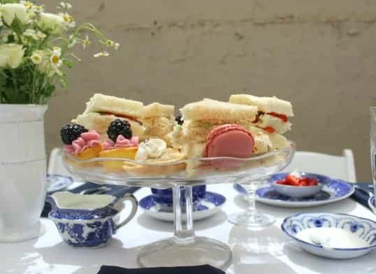 Cake stand with tea party sandwiches and cookies