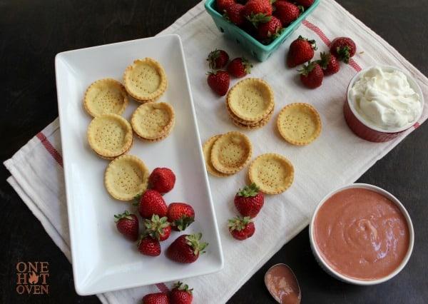 baked tart shells and strawberries