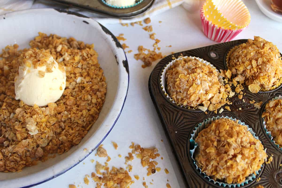 Rolling ice cream balls in cereal and putting in muffin tins,