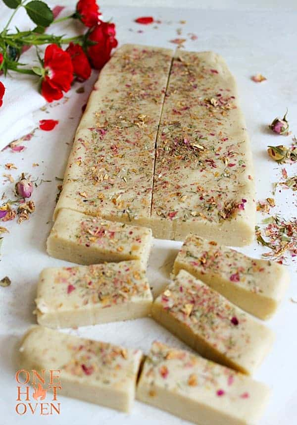 Slicing rose petal shortbread dough
