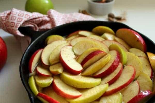 sliced apples on cake batter