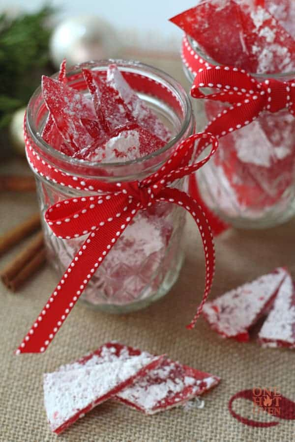 A jar of Cinnamon Rock Candy with a red ribbon for gifts