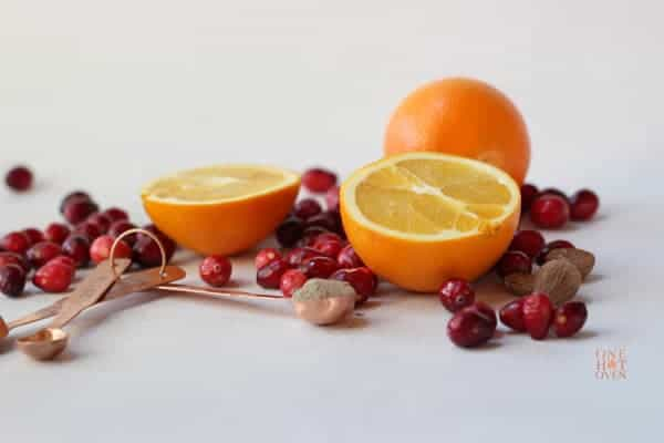 oranges and cranberries with measuring spoons