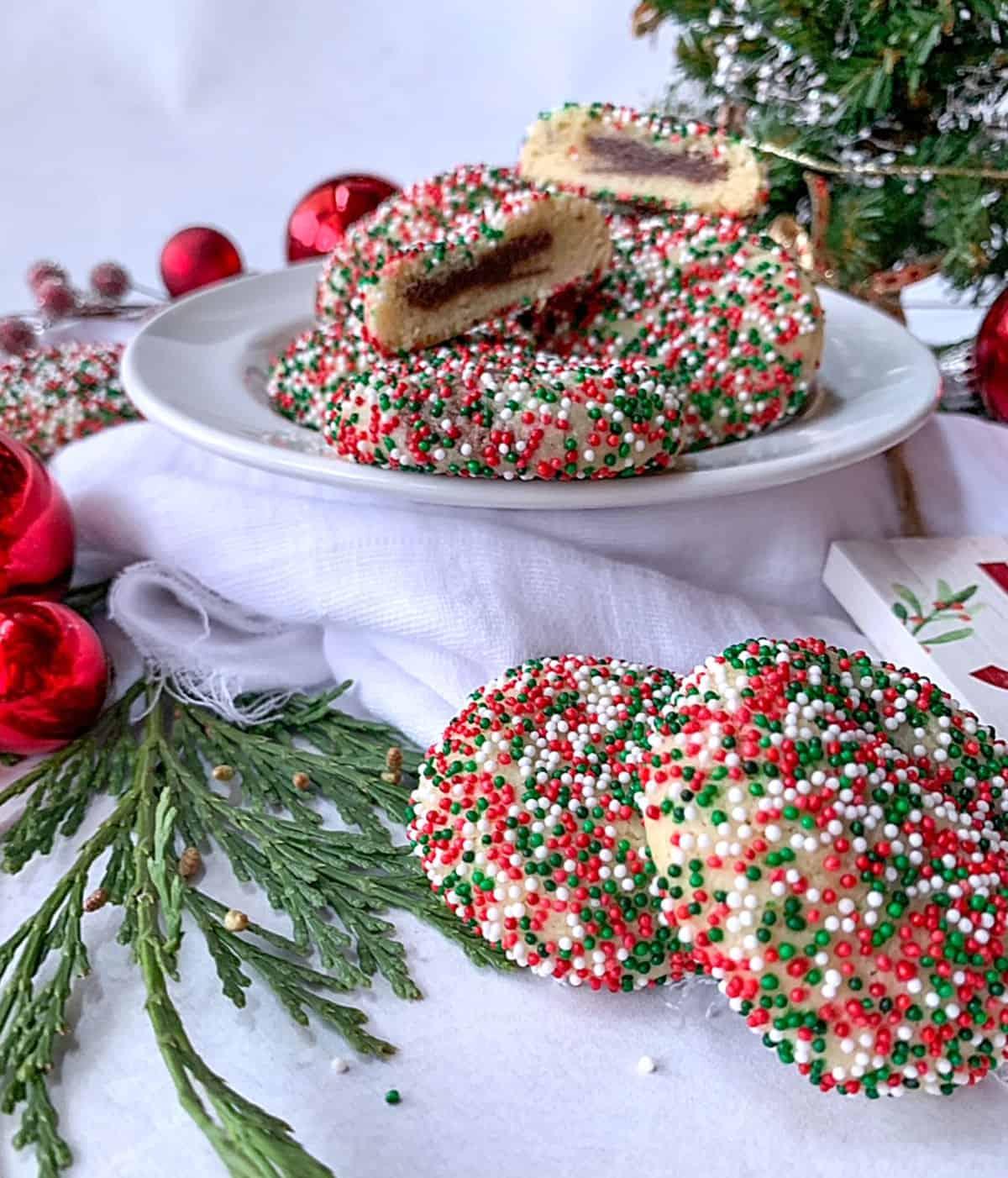 a plate of sprinkle cookies