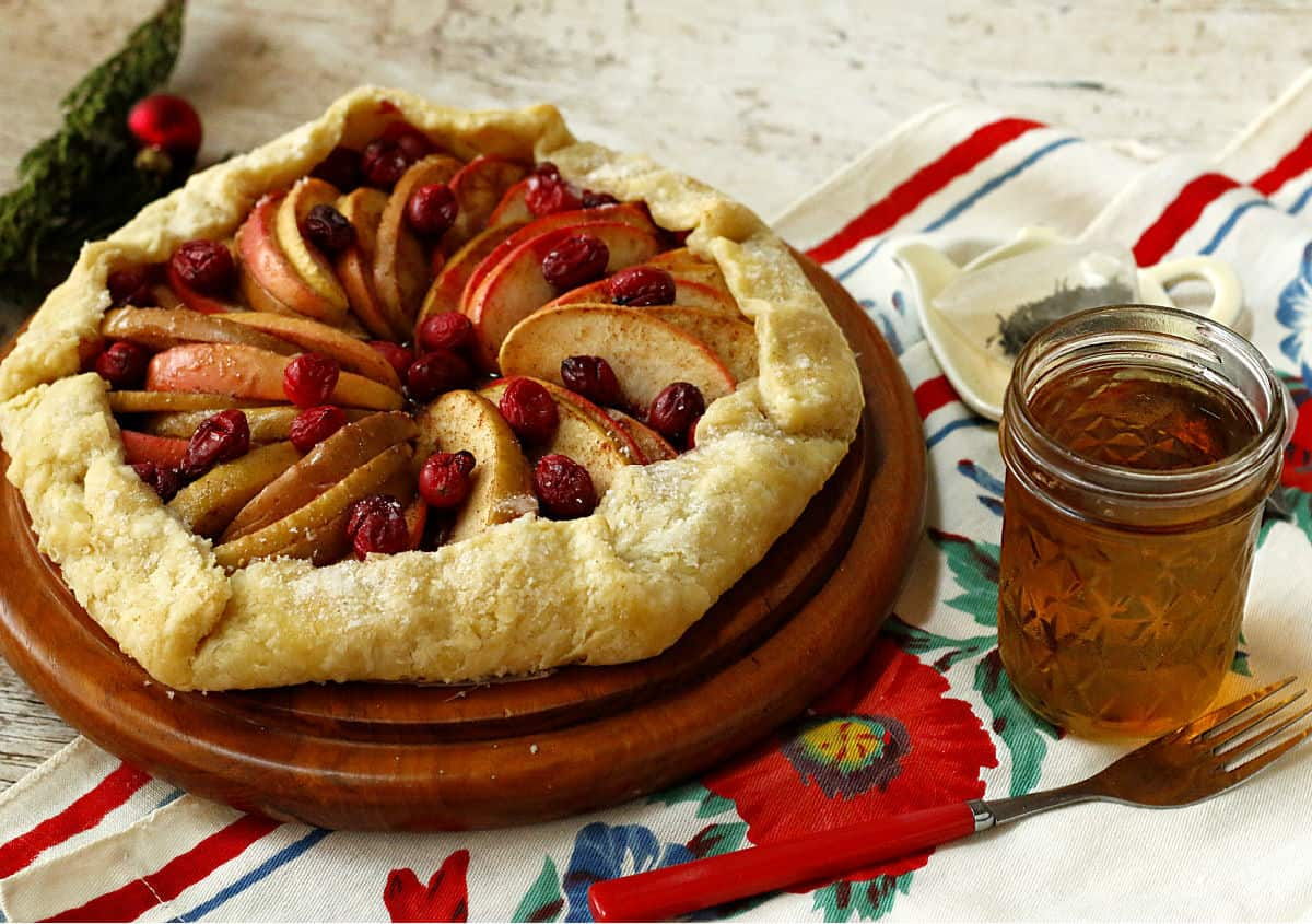 Apple cranberry galette with a cup of hot tea