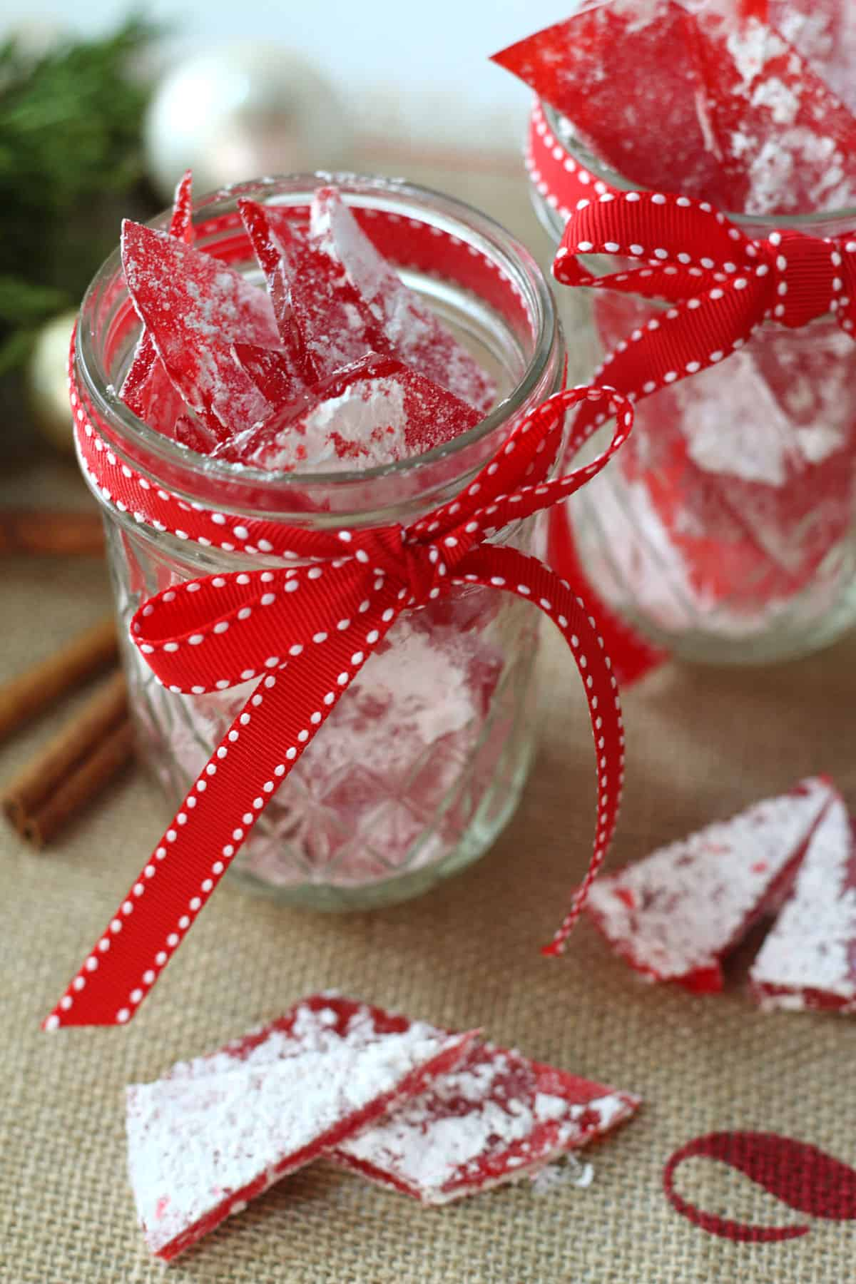 Cinnamon glass candy in a mason jar with a red ribbon.