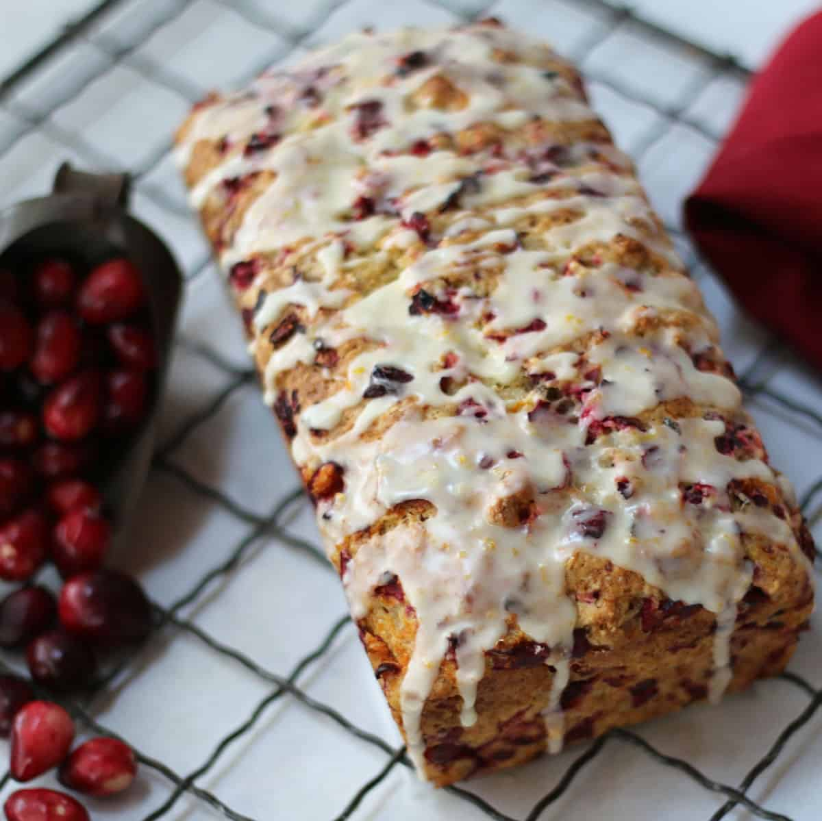 a loaf of iced orange cranberry bread