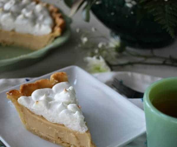 A slice of butterscotch pie and tea