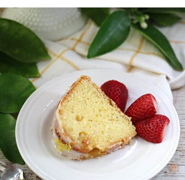 Sliced lemon bundt cake with strawberries