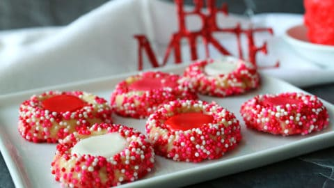 Red, white and pink iced cookies with spirnkles.