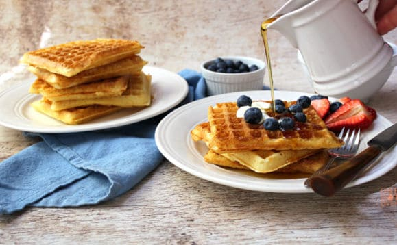 pouring syrup on waffles