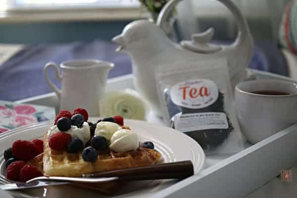 Raised waffles on a tray with tea