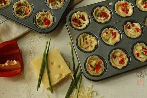 unbaked mini Swiss cheese quiches