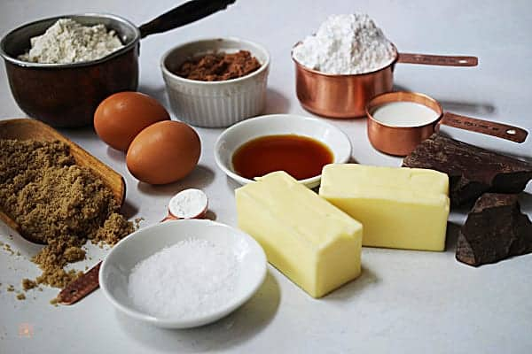 Ingredients for making a chocolate cake torte, butter, flour, sugar, eggs, cocoa powder