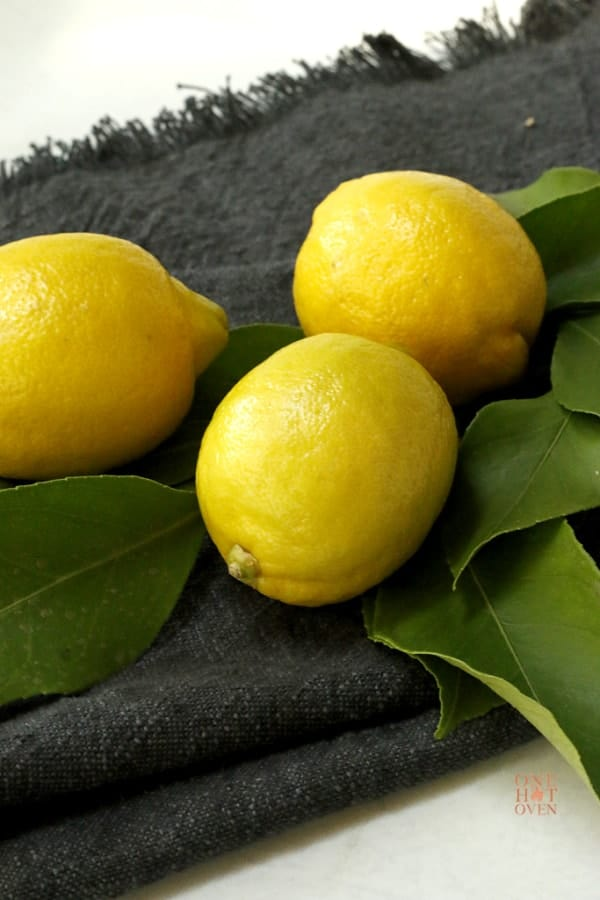 Fresh picked lemons sitting on a black napkin