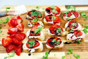 A tray of strawberry and feta cream cheese crostini