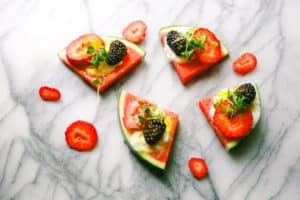Slices of watermelon pizza with fruit