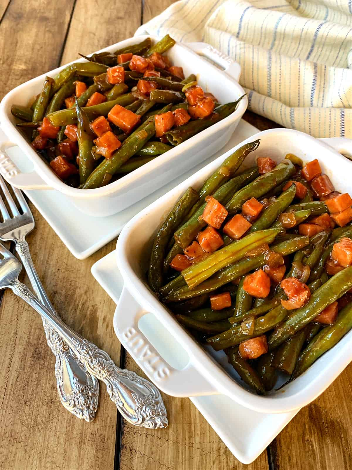 Green beans in two white casserole dishes.