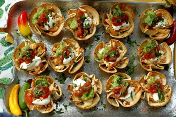 A tray of mini chicken taco cups