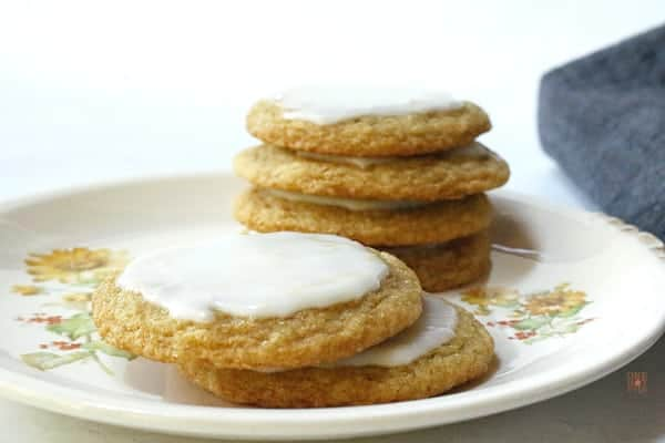 A stack of Chewy Lemon Cookies with lemon icing