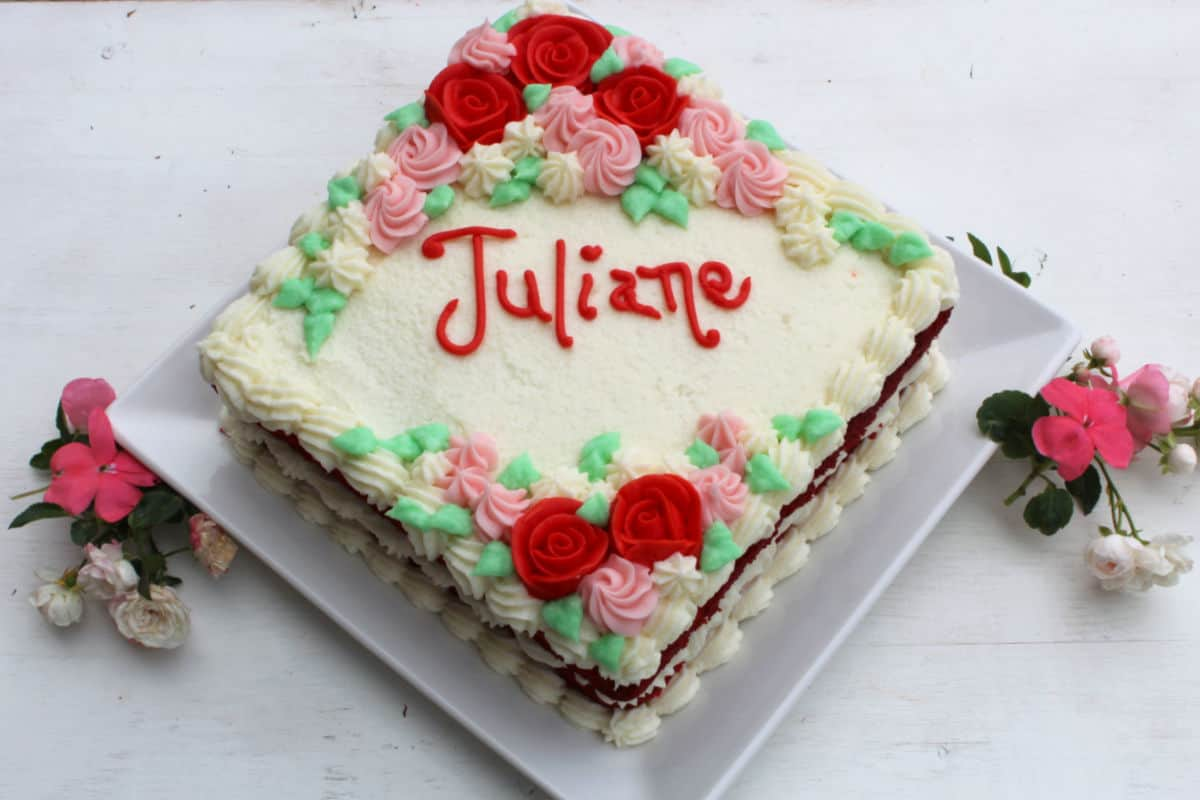 The top view of Juliane's birthday cake decorated with flowers.