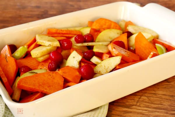 Sweet potatoes, apples and cranberries ready to roast