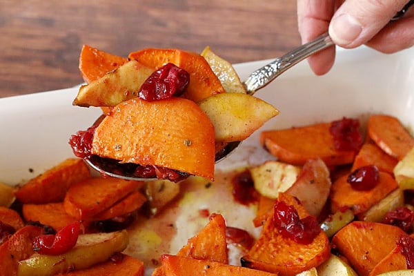 A spoonful of baked sweet potatoes and apples